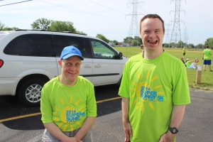 Two of the men we serve, having a blast cheering for finishers at the 2014 Super Sunny 5k